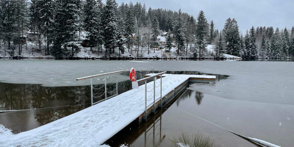 Alone,Pier,With,Orange,Lifebuoy,With,Frozen,Water,Around.