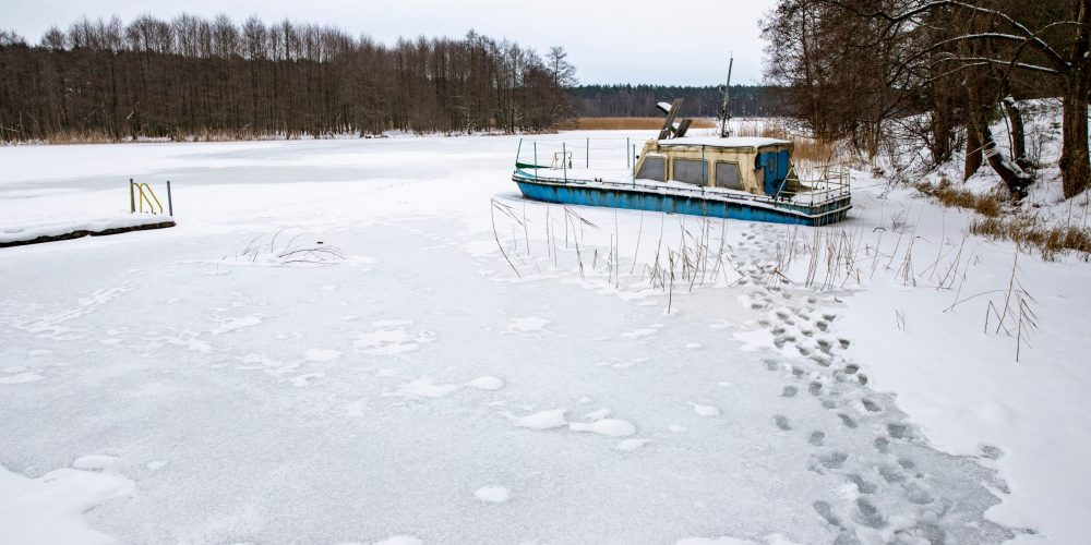 A,Large,Boat,Trapped,In,Ice,On,A,Lake.,A