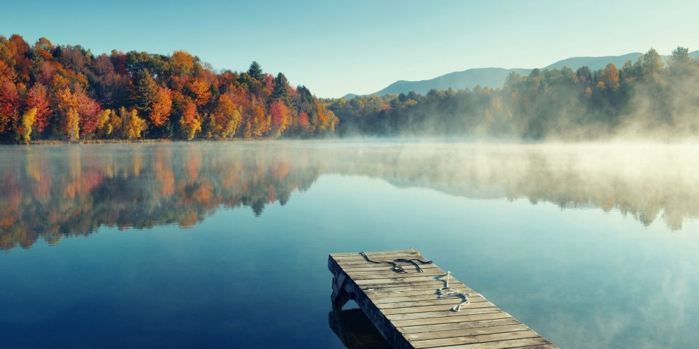 Autumn,Foliage,And,Fog,Lake,In,Morning,With,Boat,Dock